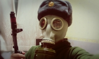 Man wearing a soviet era gas mask as parto f the Soviet Era Survival Drama